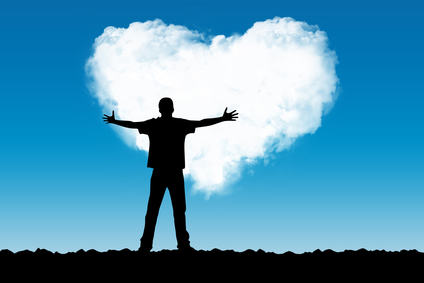 The person stretches hands to a cloud in the form of heart